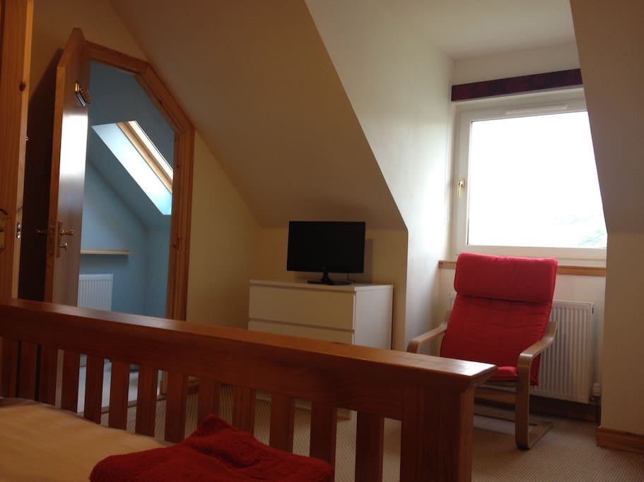 Double bedroom with ensuite shower  and excellent sea views.