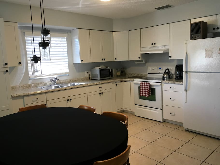 Cozy kitchen fully furnished with all cookware available for you to use, including coffee maker, toaster, microwave and refrigerator