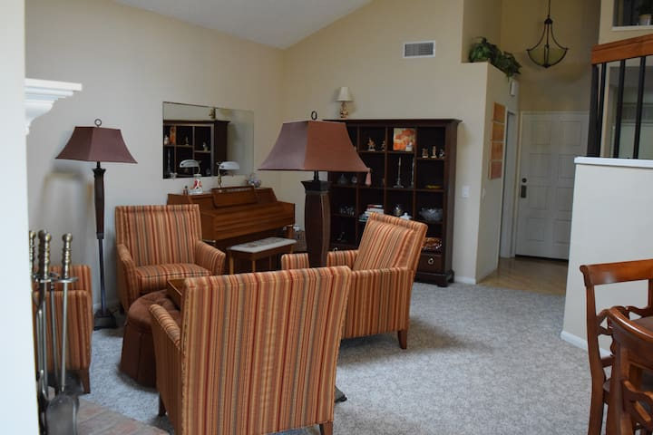 Living room conversation seating and piano