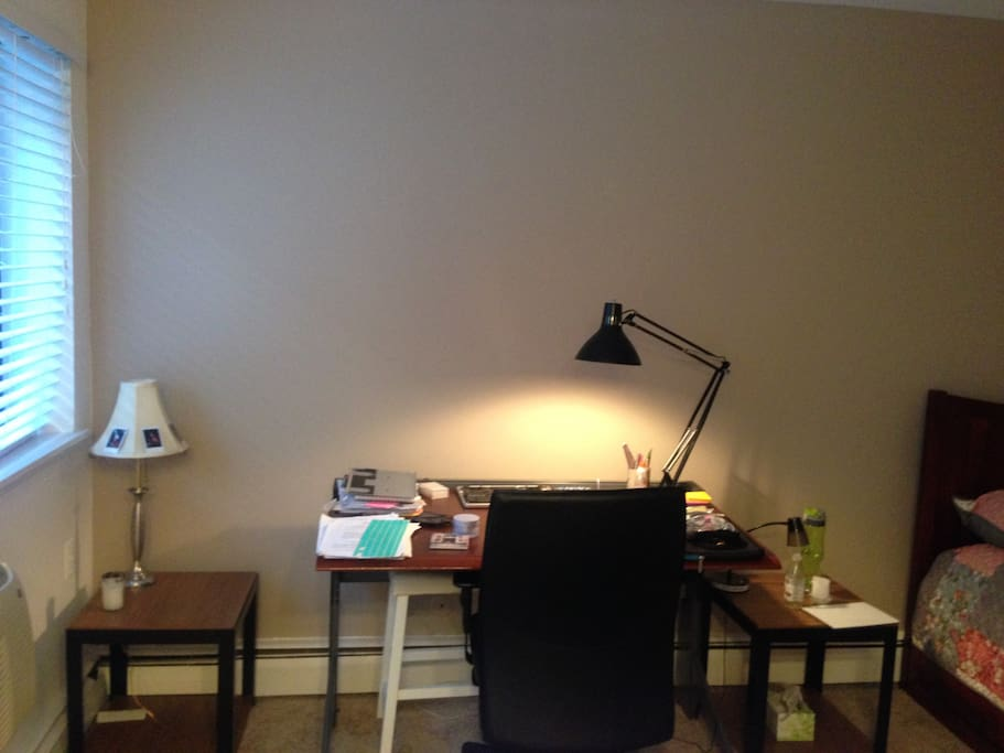 Desk and a comfortable chair and lamp for study
