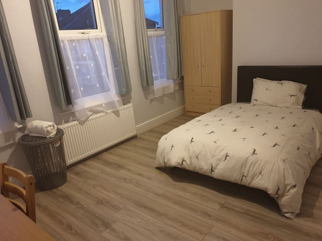 Bright spacious room with small double bed