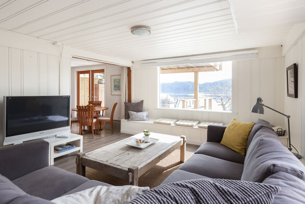 French doors open on large personal BBQ deck and private steps down to your own walk-on beach.