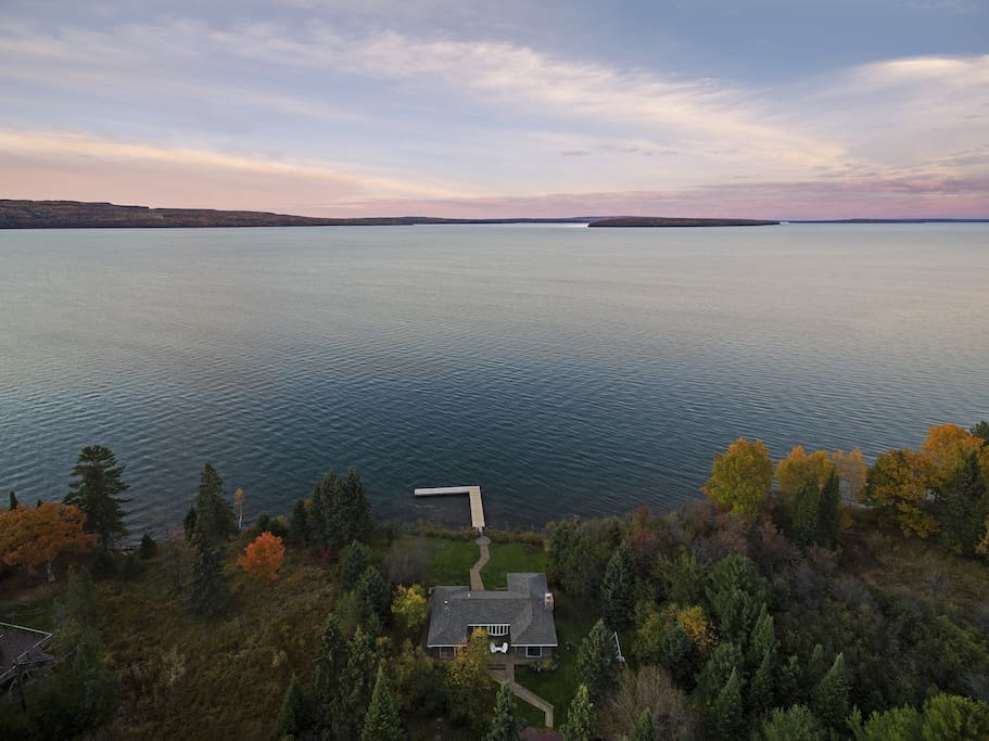 Situated right in Sunset Bay- you will delight in sail boat races and be able to wave to the ferry. Please note: this is a view to show where we are situated on lake. The house you see is the main house and is our private residence. Dock is still accessible.