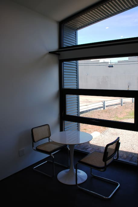 Back room, table and chairs, operable window. . .