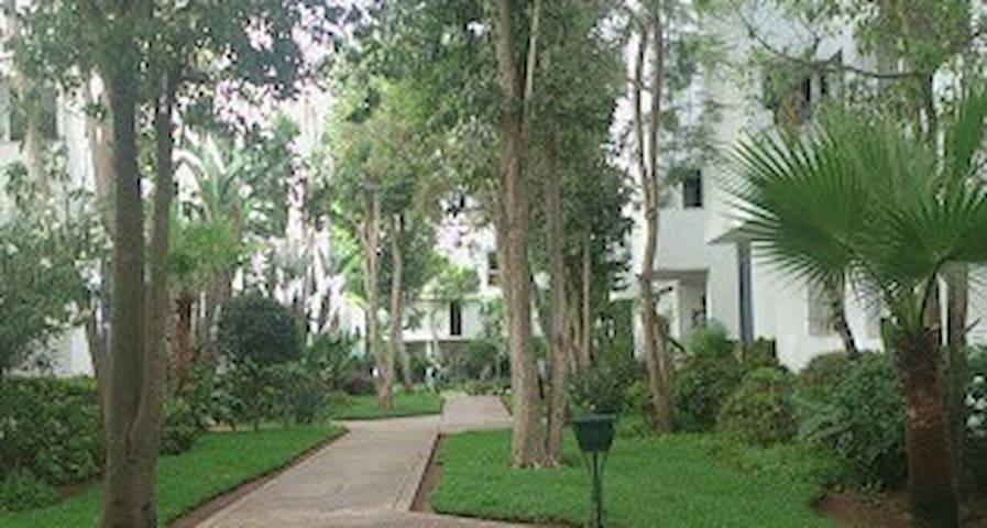 Bel appartement RDC spacieux au coeur d'un  jardin