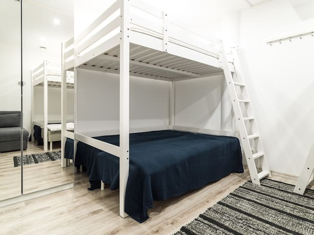 Room with six beds, one bed sofa. Up to nine people!