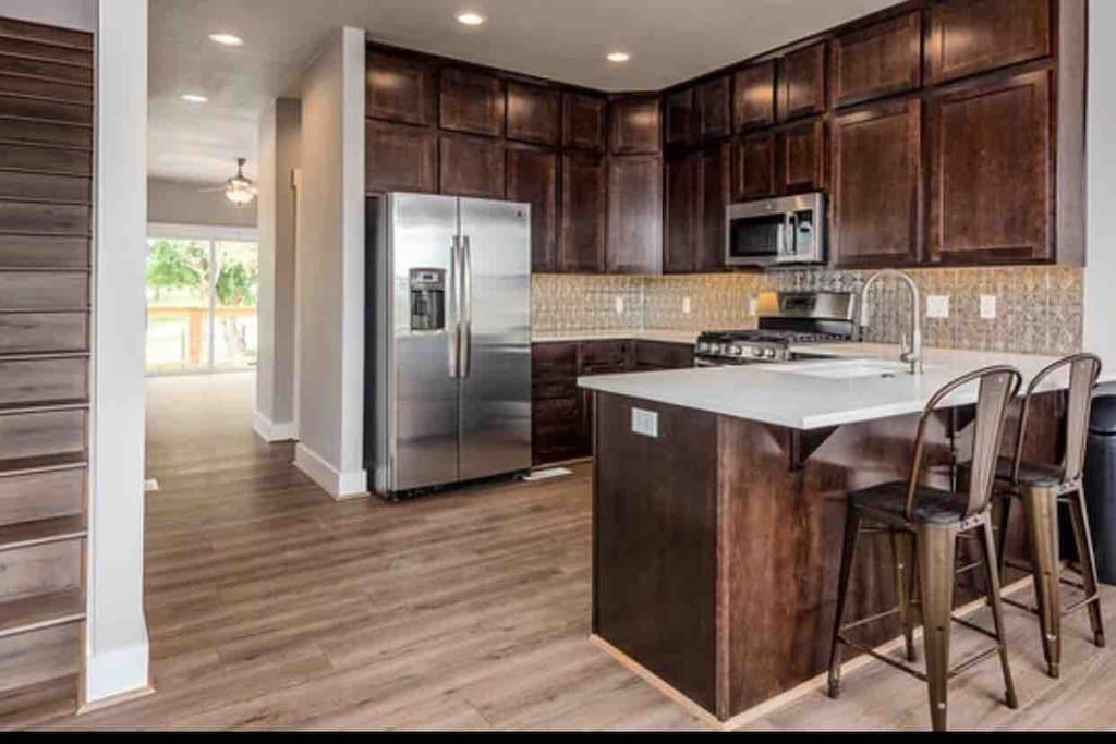 Kitchen with brand new appliances.