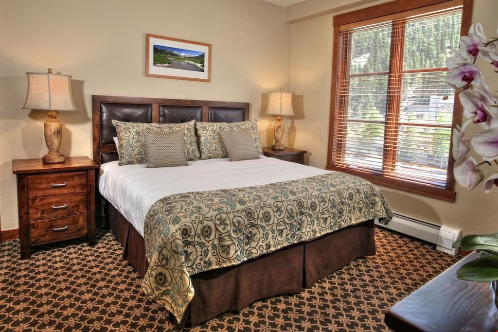 Sink back into the luxurious king-sized bed in the bedroom.