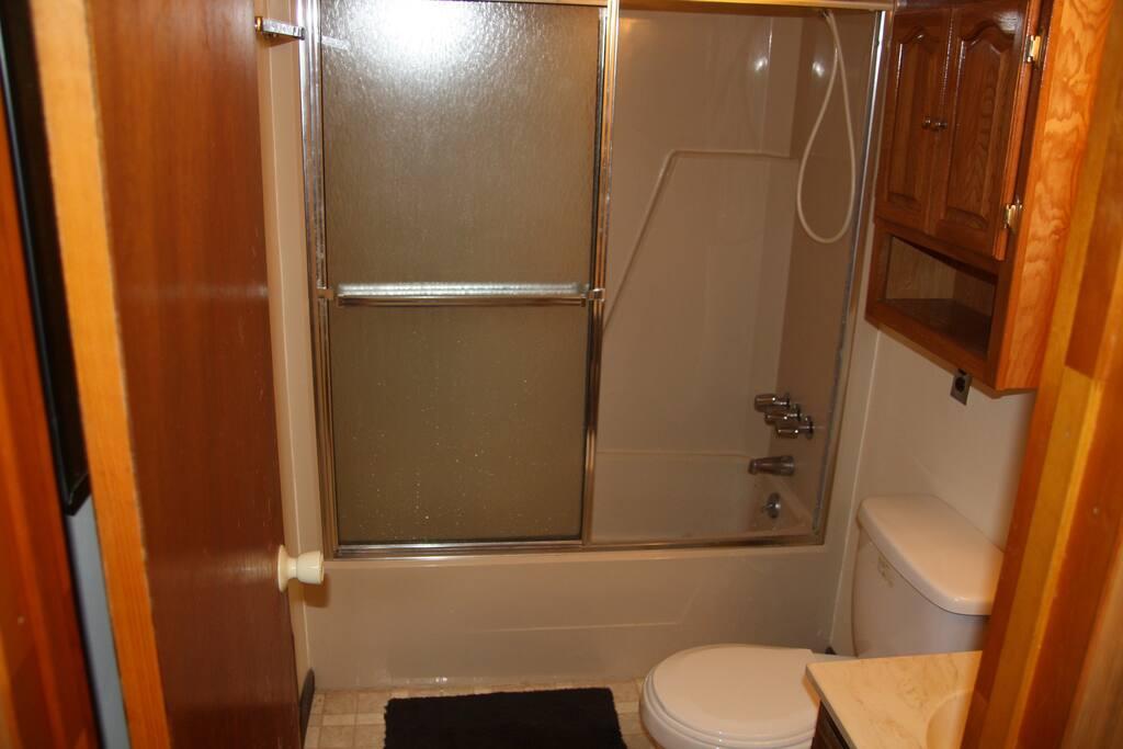 Single sink bath with tub/shower.