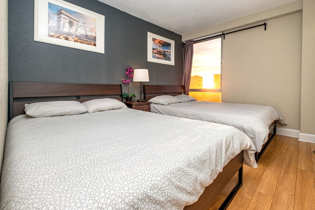 The second bedroom also includes two queen size beds with luxurious sheets for a restful night's sleep.
