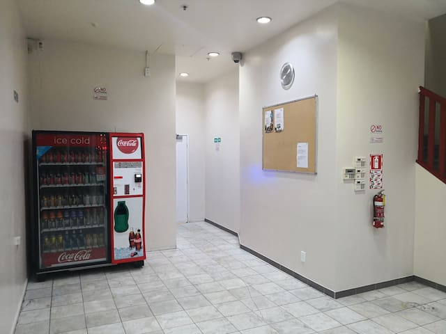 This is the lobby area, the elevator is at the corner next to the Coca Cola vending machine.