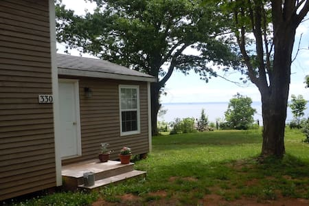 Blomidon Rose Fan Cottage by the water.