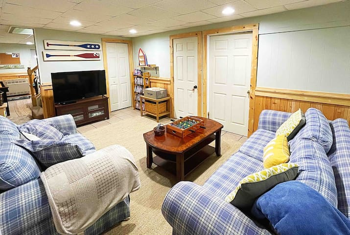 Open and bright den area with Giant Jenga, Smart TV, Bluray player, and DVD selection.