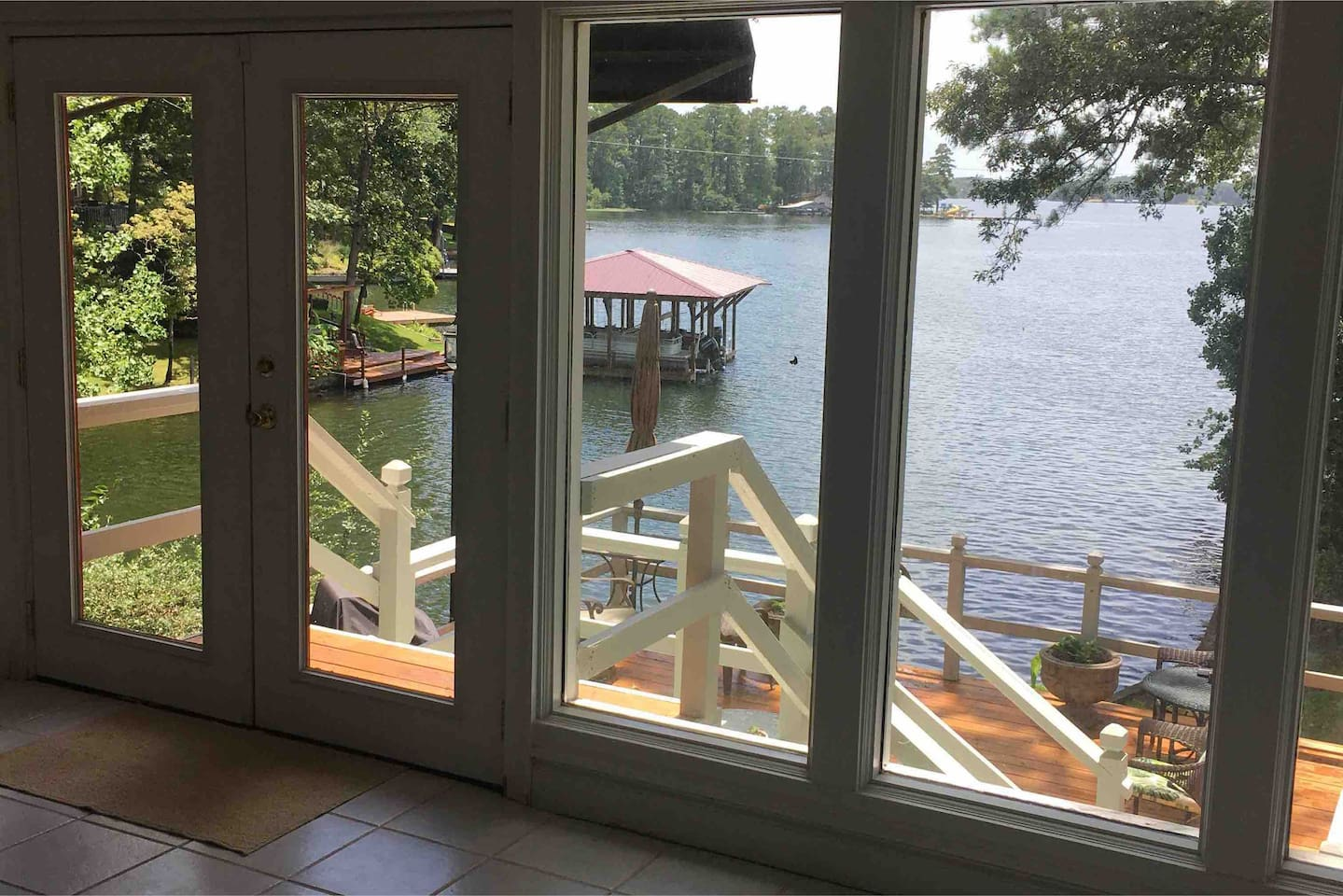 Panoramic views from the sunroom. Home is right on the water! Deck in the back of the house with plenty of seating to enjoy the view!