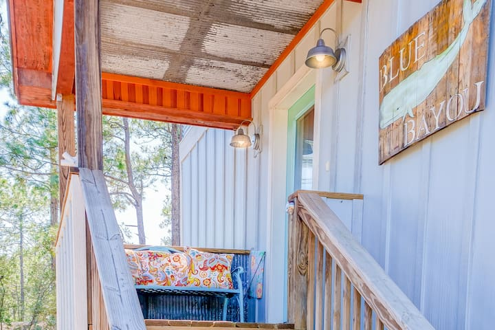 Covered side entryway with a place to plop down! Blue Bayou has Motion Sensor Outdoor Cams and Keyless Entry.