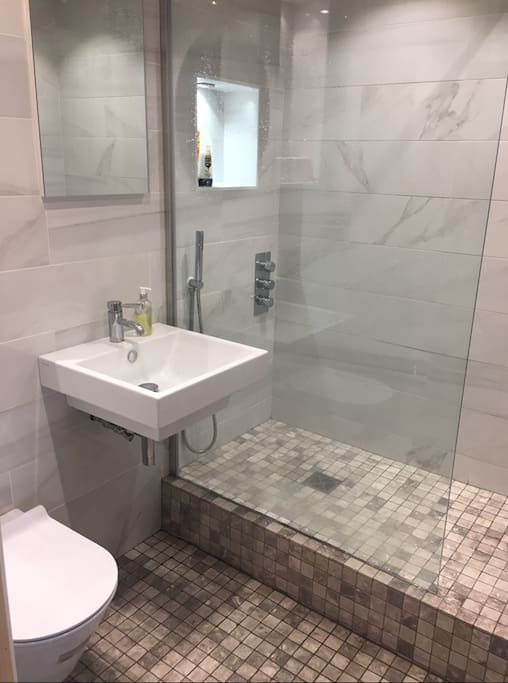 Brand new luxury bathroom with endless hot water from communal boiler!