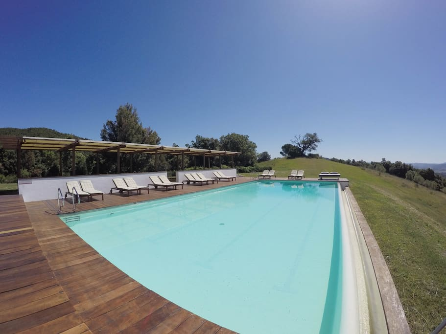 Relax with a glass of local wine and enjoy our infinity pool