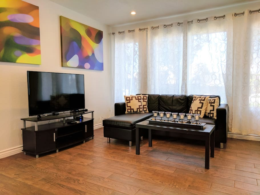 The living room is extra bright and relaxing, featuring remote controllable LED ambient lighting and live cable TV service.