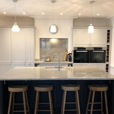 Kitchen - integrated fridge freezer,  hob, ovens, microwave, dishwasher, coffee machine.