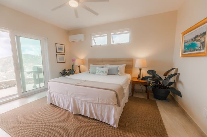Wake up to a view of Coral Bay from the extremely comfortable king size bamboo mattress. Airconditioning is available, but much of the year cool breezes make sleeping in the fresh air restful.