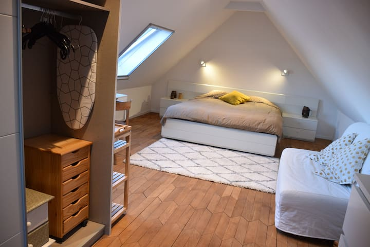 Spacious and bright attic room on the water