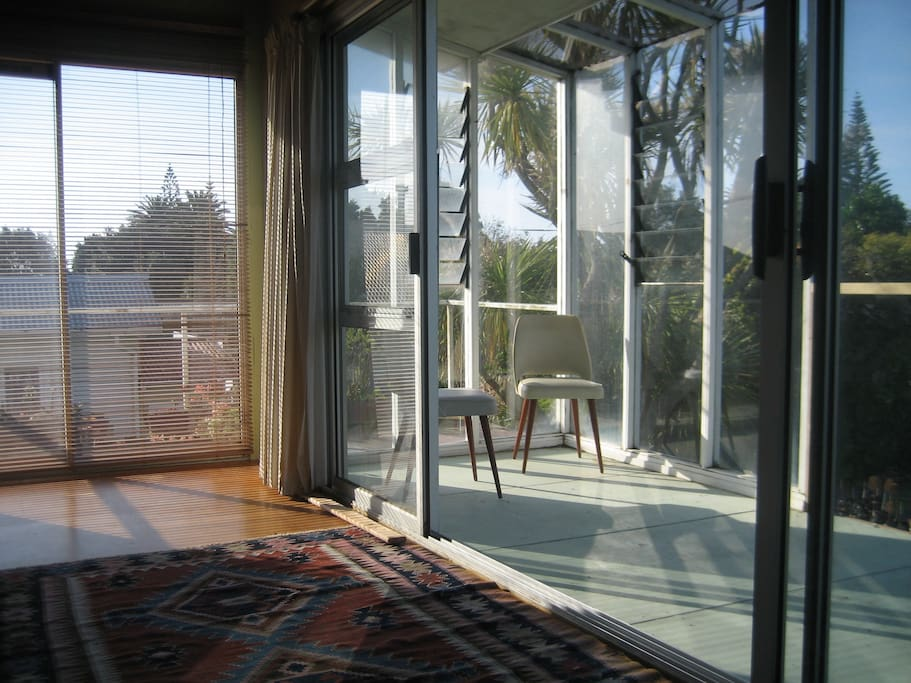 Sliding doors to partially enclosed deck. It's a sun trap!
