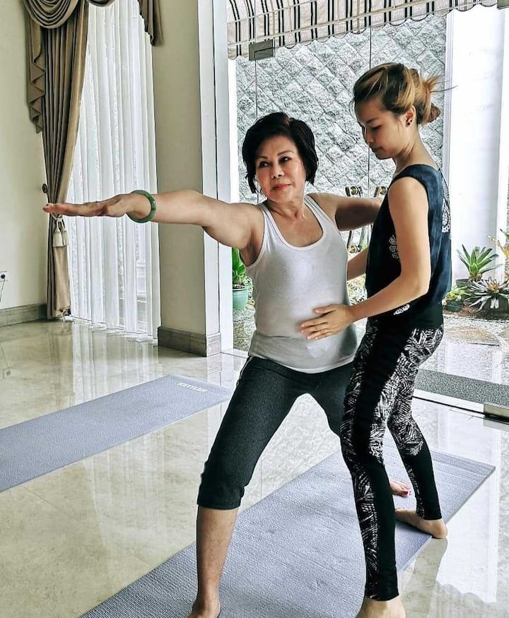 Teaching a 70-year-old grandmother yoga