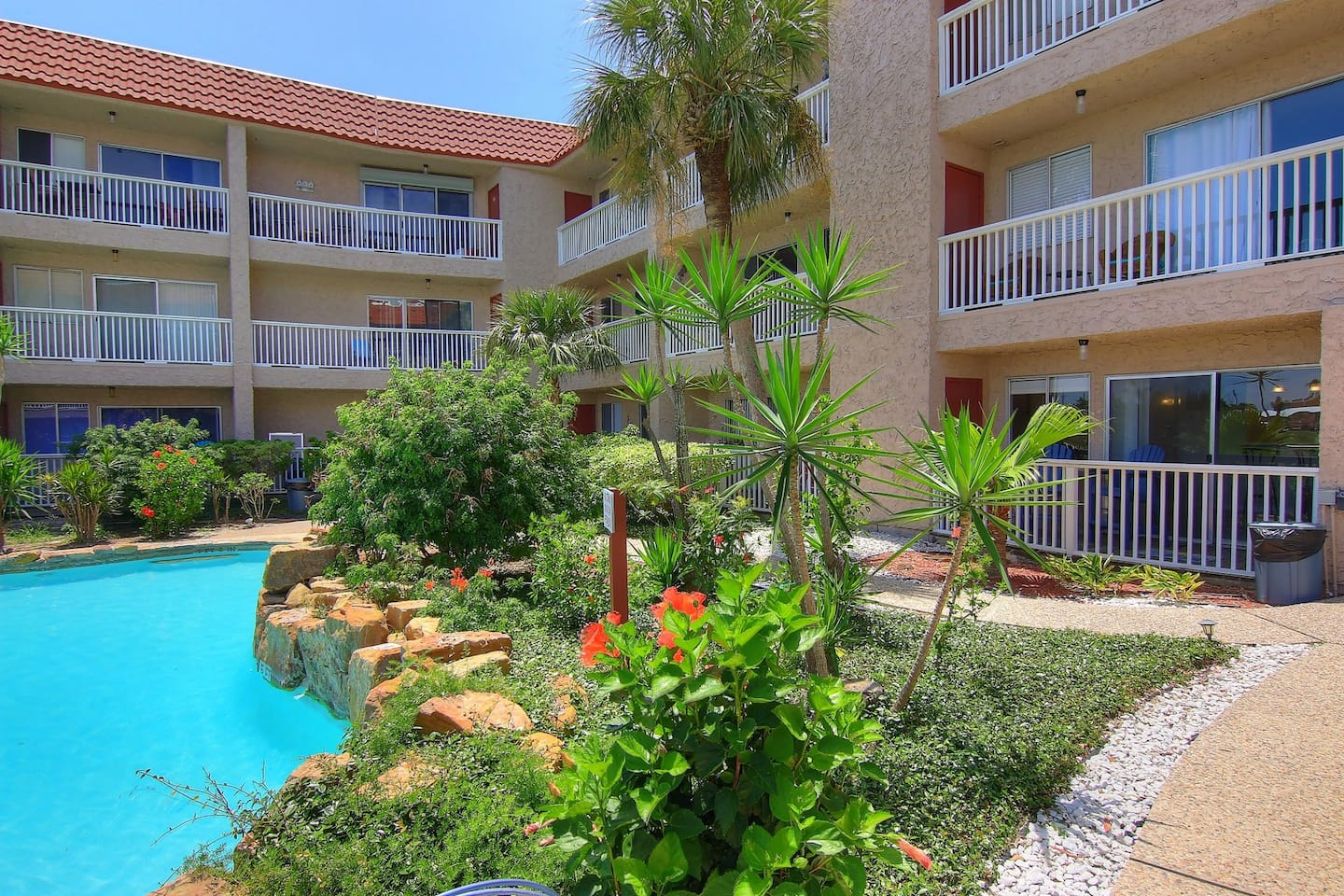 Modern poolside condo with shared pool and fishing docks!