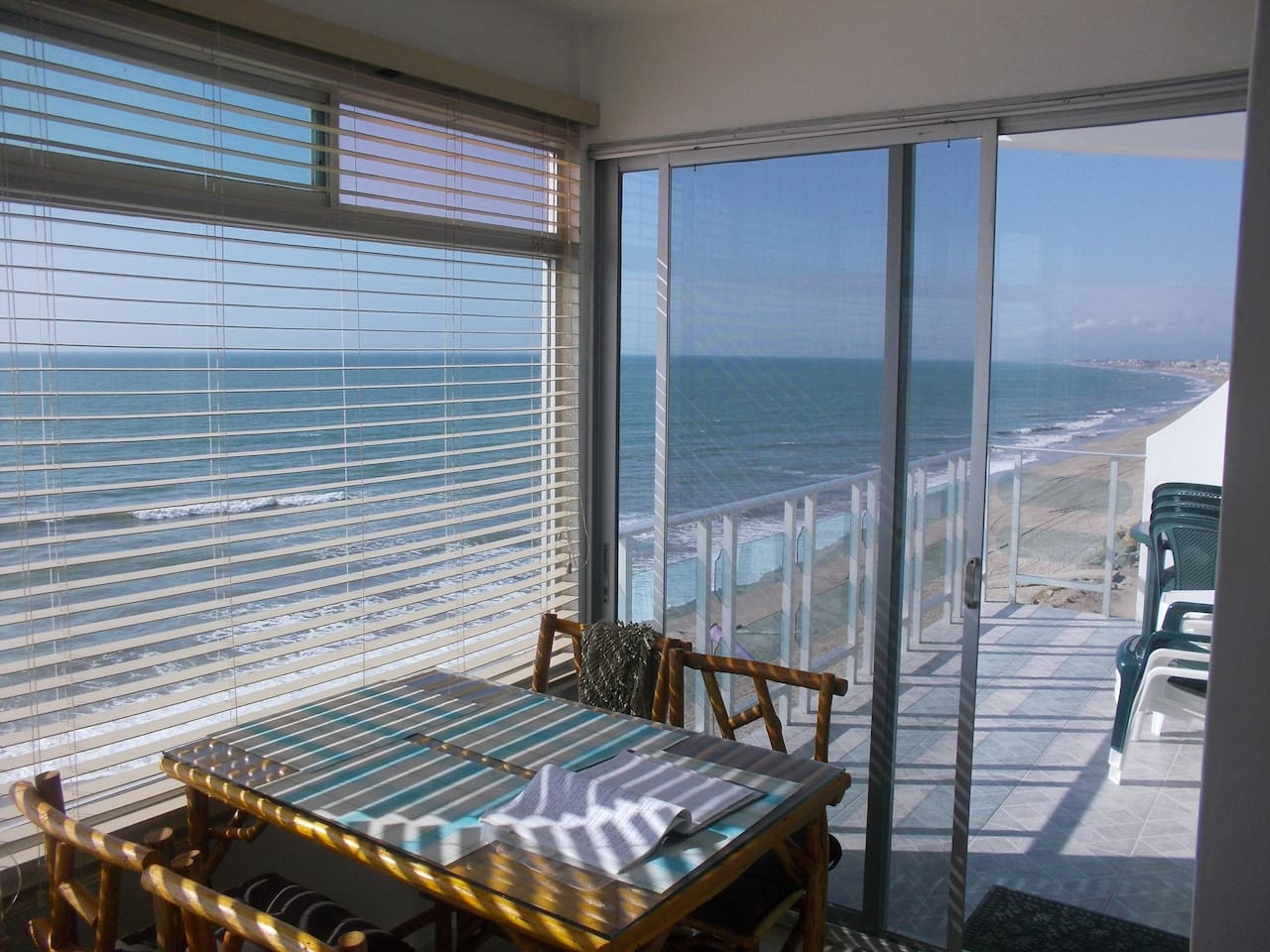 View from Kitchen Dining Nook to Balcony and the Pacific Ocean, North to Crucita Centro