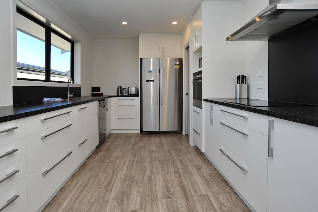 The spacious kitchen is fully equipped