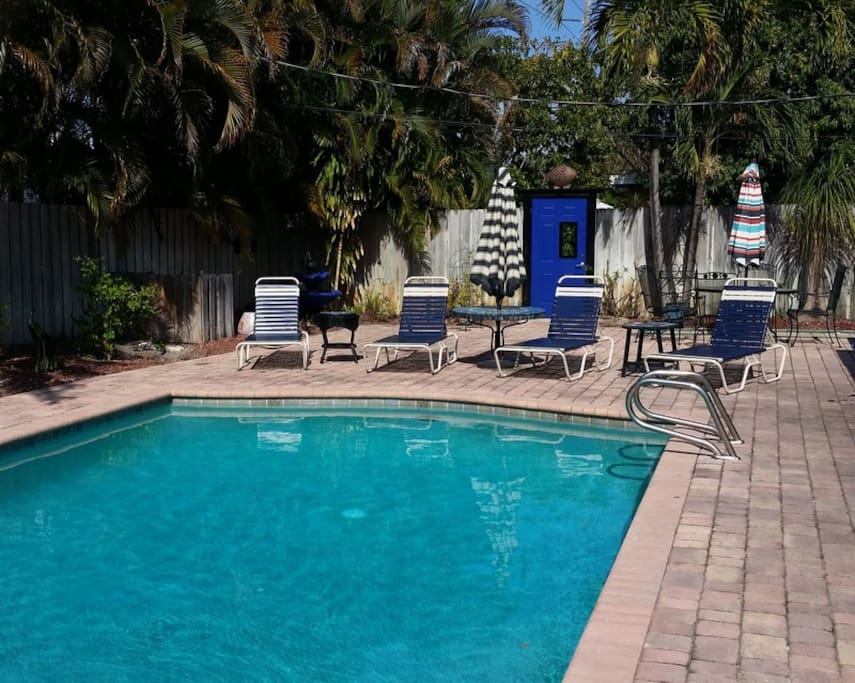 Oversized pool and patio area just a few yards from your space through the blue door