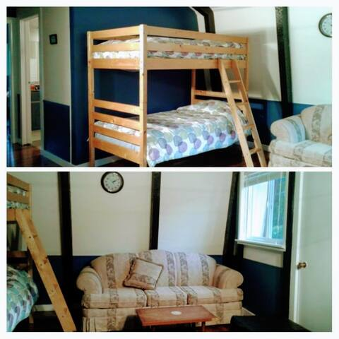 Upstairs common area with bunk beds and sofa bed.