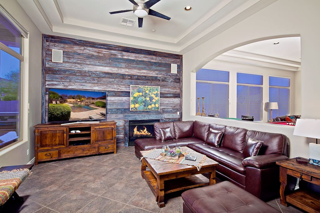 Formal living room with large hd tv and cozy fireplace.