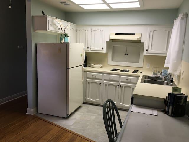 Kitchen with refrigerator, range, dishwasher