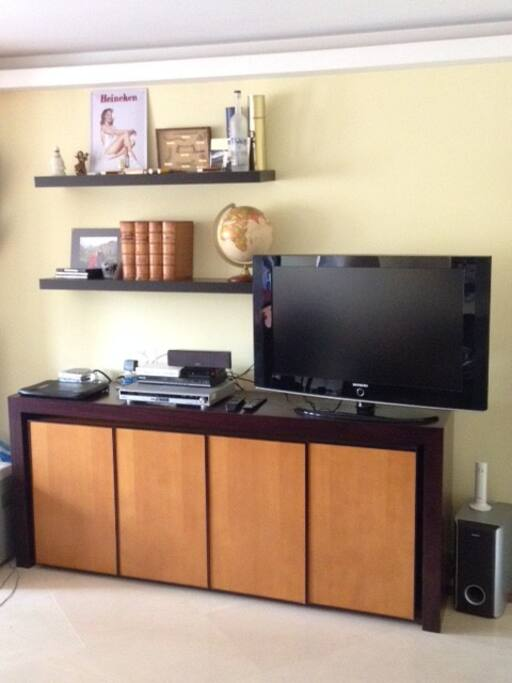 Living room, flat-screen tv with DVD player and 5.1 sound system.