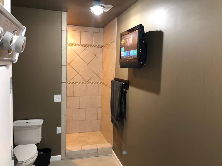 Bathroom has washer/Dryer large custom tile shower and YES a TV