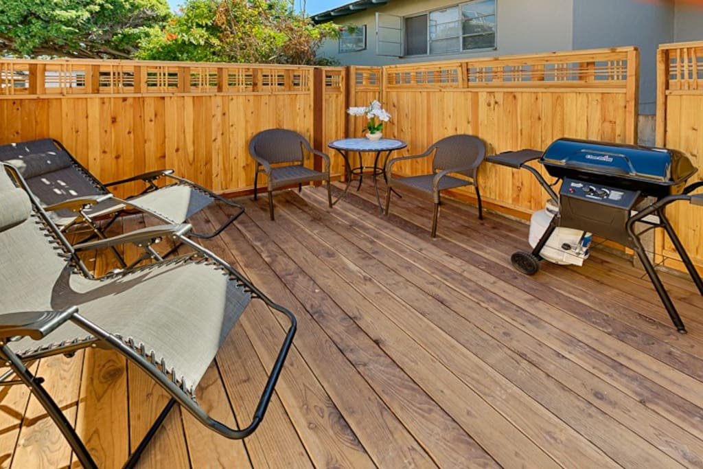 The patio features space to lounge, BBQ, and relax