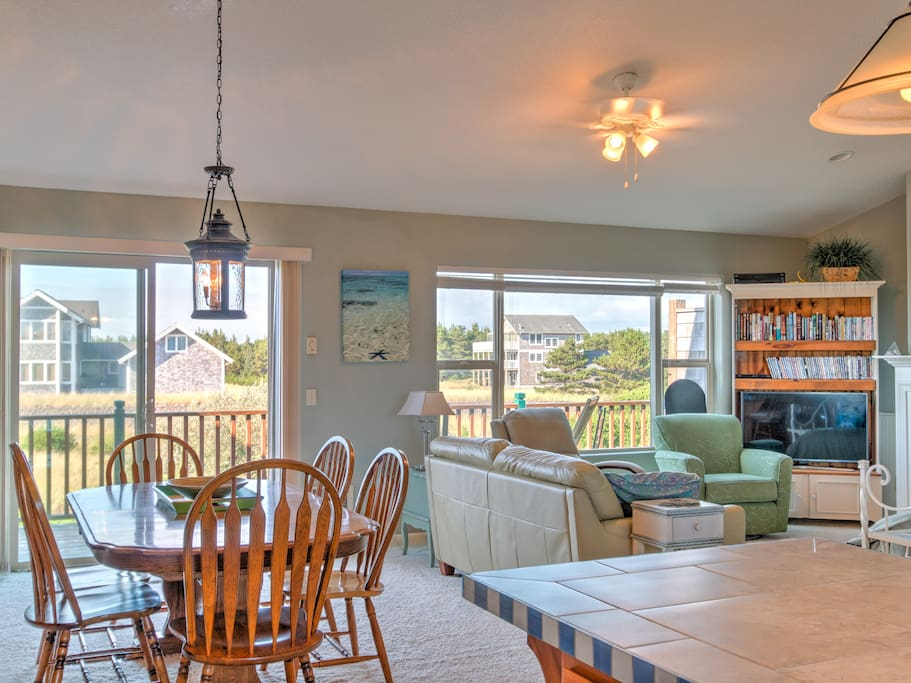 Enjoy the wide open floor plan connecting the living room, kitchen, dining area and front deck