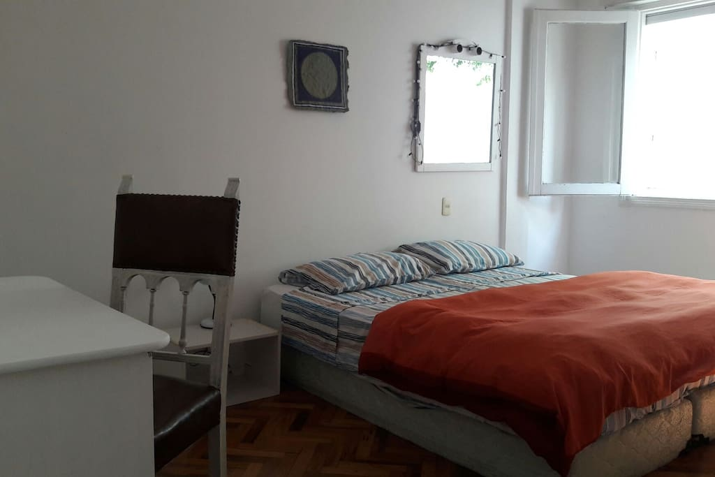 Matrimonial room. Queen size bed, a wordrobe , a bedside , a tv and a mirror. Size : 20 square meters aprox. It counts with a window  facing to the Carlos Berg street. Comfortable and cozy room.