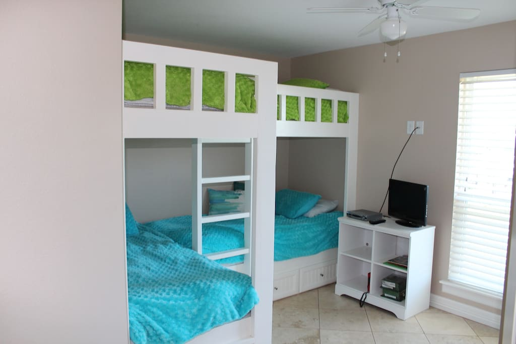 Bunk room with four double beds.