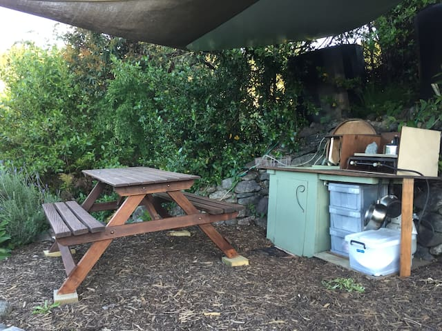 Picnic table and overhead shade cloth and PVC cover, amongst the lavender bushes.  This is where breakfast will be served.
