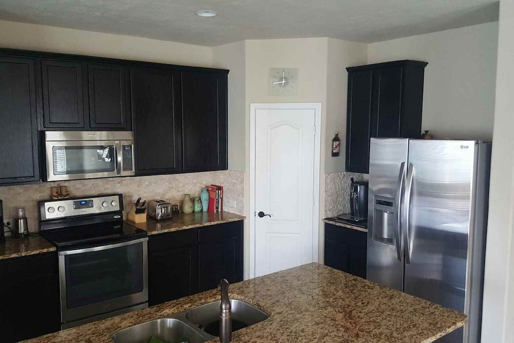 Full kitchen with all stainless steel appliances.