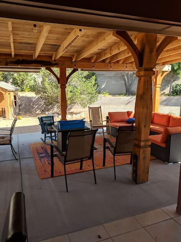 Enjoy the gas fire pit while lounging on the comfy couch. Seating for a dozen or more people. Also includes two tables and outdoor tv and grill.