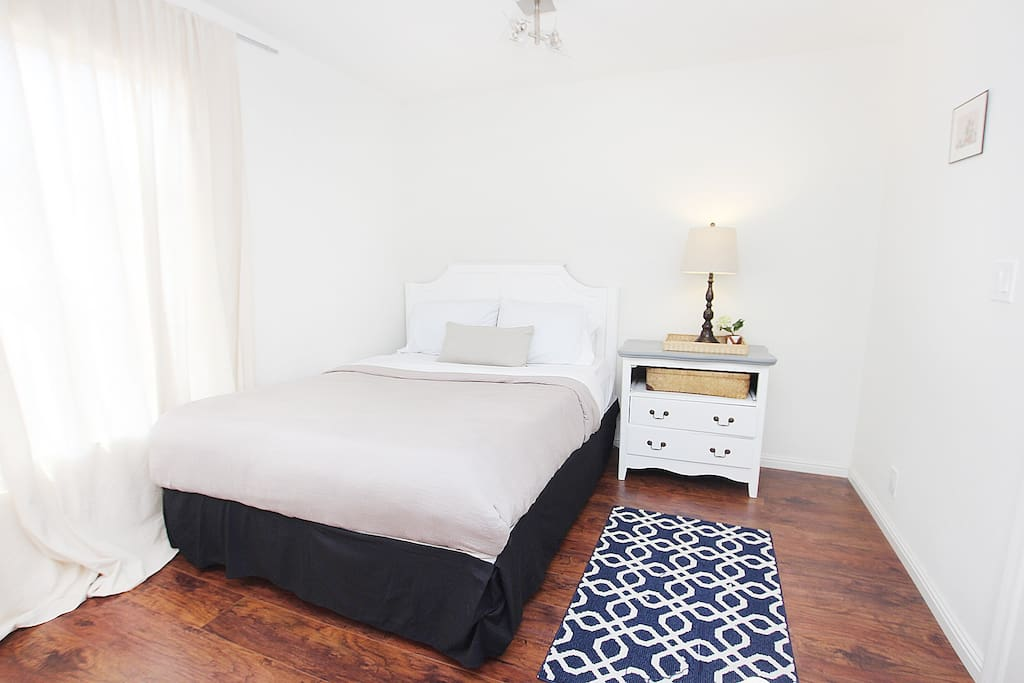 Here's a large bedroom w/a cozy memory foam Queen bed and fluffy pillows