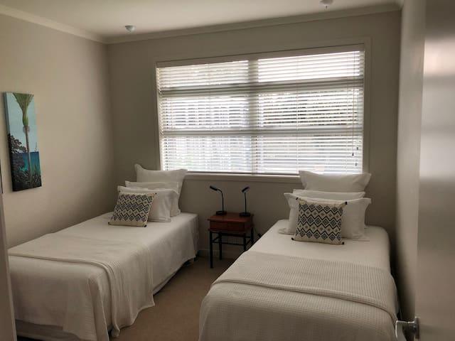 Bedroom 2 - 2x King singles