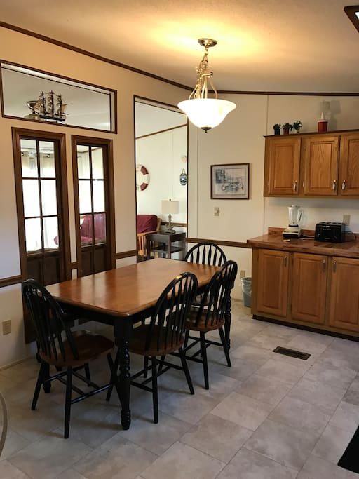 Full eat-in kitchen with full-size fridge, oven, cooktop, microwave, toaster, coffee maker, dinnerware and utensils.
