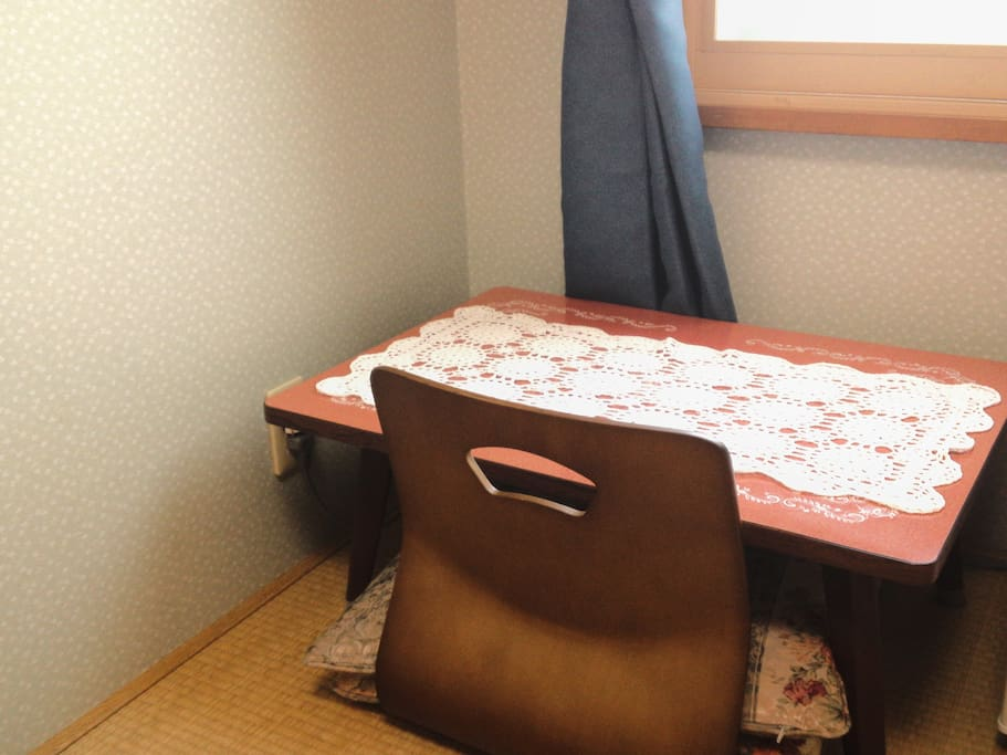 The rooms feature tatami (woven-straw) floors and Japanese futon bedding. Each comes with a seating area with a low table. Bathrooms and toilets are shared.
