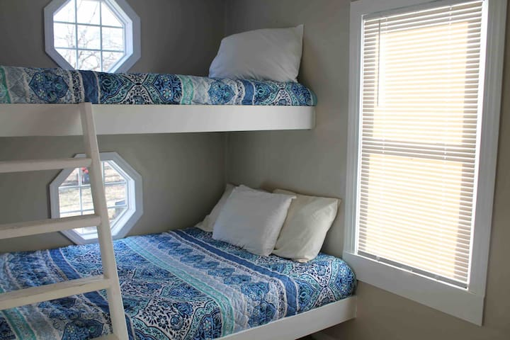 Bedroom 3–full size on bottom and twin on top (both new mattresses)—42 inch smart tv!