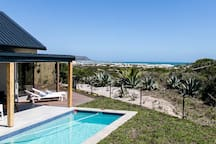 Patio & pool right on the dunes