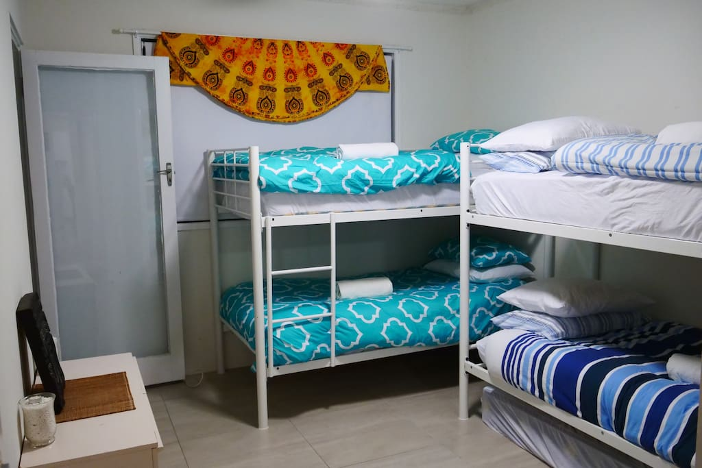The bunk room with the back entrance in view - Access the Semi-private back of building outdoor area through here :)